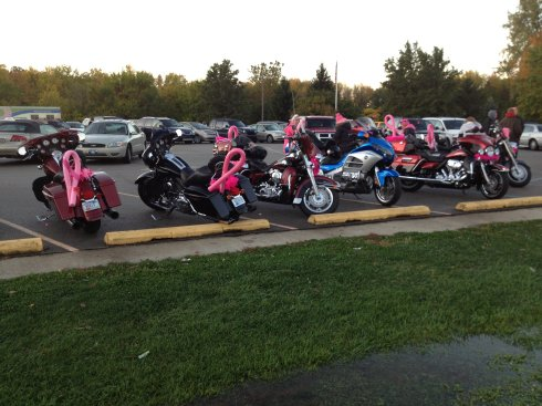 The motorcyclists involved in Walk of Hope decorate their bikes in pink ribbons.